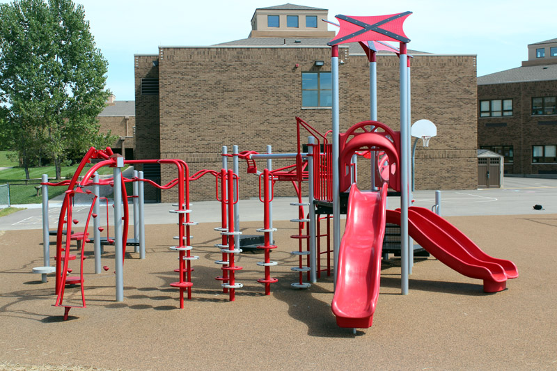 Heritage Elementary Lakota Schools, Xccent Classix playground with poured  in place surfacing.